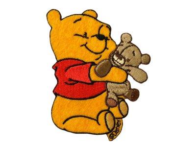 Applikation zum Aufbügeln Disney-Winnie the Pooh - Winnie mit Teddy - orange