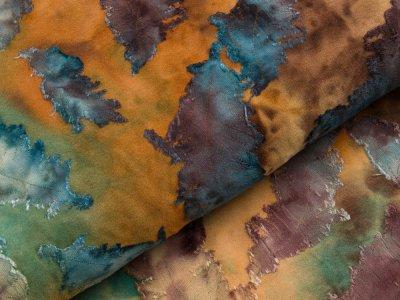 Jersey mit Ausbrenner - Federn auf Batik - ocker/pertol/braun